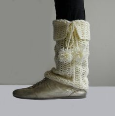 Leg warmers with pompoms!