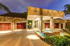 modern porte-cochere welcoming with pond