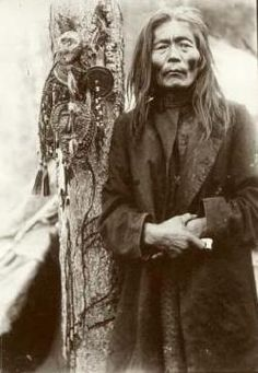 Siberian Evenk shaman with a collection of shamanic objects, including images of helper spirits, early 1900s.