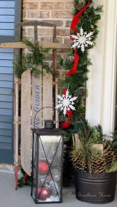 Dreaming of a White Christmas Porch - Our Southern Home -----Sled, lantern with bulbs and snow - with wood bucket