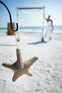 Shepherd's hook with starfish - love for destination wedding