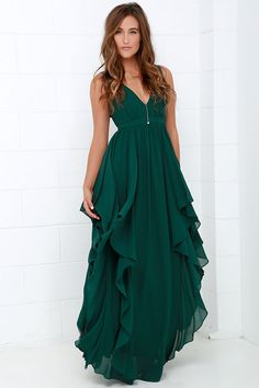 We can't help falling in love with the Water-Falling for You Dark Green Maxi Dress! Lightweight Georgette fabric forms a lightly padded, sleeveless bodice with a plunging neckline and princess seams. Ruffling tiers of fabric cascade from the high waistline to create a show-stopping floor-length maxi that begs to be twirled in. Hidden back zipper/hook clasp at back. Fully lined. Self: 100% Polyester. Lining: 95% Polyester, 5% Spandex. Dry Clean Only.