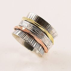 """Sterling Silver, Copper and Bronze Spinner Ring  DETAILS: * Size 5 & 6 1/2 * 7 g total weight * SOLID .925 Sterling Silver * Stamped .925 * Measures approximately 1/2"""" wide  Spinner Rings are also"""