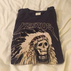 YEEZUS Tour T-Shirt ⚠️NEVER WORN⚠️ Authentic T-Shirt from Kanye West's most recent Yeezus tour. Dark grey complete with the skull in Native American headdress and red Yeezus writing in the middle of the back. It's an XL because that's all they had left but I bought two of them and cut mine to be cute!! Yeezy Tops Tees - Short Sleeve