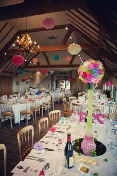 bright and colourful wedding flowers and pom poms