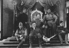 Soviet soldiers sitting on the throne of emperor Pu Yi, leader of the Japanese puppet state of Manchukuo, China, 1945