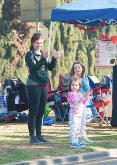 Alyson Hannigan watches the LA Marathon with daughters Satyana and Keeva Denisof