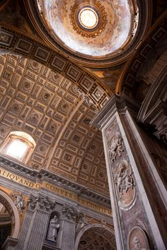 Ceiling inside St. Peters Basilica. To appreciate the enormity of this building, the size of the lettering is 6' in height.