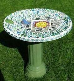Old tv dish turned into a bird bath