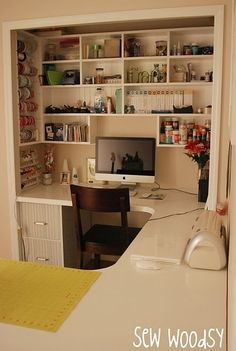 Craft space-appears to be a closet turned into a  u-shaped desk w/ shelves built in to it for storage