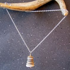Cairn Necklace stacked beach stones hanging from a by BlackStar