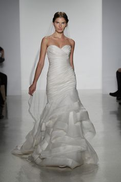 So gorgeous! Peri- fit to flare silk organza ruched wedding dress with flounced layered skirt and raw edge trimmed detail
