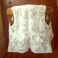 Anthropologie Hei Hei Ruffle Vest Ruffles at the back and a delicate print give this vest a romantic style. It features gorgeous details.    Never worn, NWOT. Anthropologie Tops