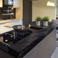 Black granite countertops are making a big comeback into our kitchens! Unlike brown granite that can seem dated, black always looks sophisticated. 😊 😍 Read more about it on our website! Cheap Kitchen Tables, Granite Kitchen Table, Kitchen Countertops, Galley Style Kitchen, Buy Kitchen, Kitchen Decor, Kitchen Design, Kitchen Ideas, Black Granite Countertops