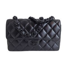 Chanel Black Classic Flap with Black Chain | From a collection of rare vintage handbags and purses at https://www.1stdibs.com/fashion/accessories/handbags-purses/