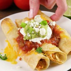 These easy Baked Chicken Taquitos are stuffed with chicken and cheese and make a great appetizer or meal. These homemade taquitos are a family favorite! Plus, learn how to make taquitos you can freeze for later! Chicken Taquitos Baked, Easy Baked Chicken, Baked Chicken Recipes, Chicken Toquitos, Baked Tacos, Rotisserie Chicken Tacos, Homemade Taquitos, Taquitos Recipe, How To Make Taquitos