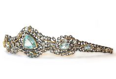 Aquamarine and diamond diadem. Detaches to form a brooch and earrings.