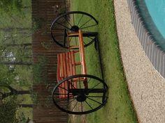 My cedar swing in the wagon wheel frame