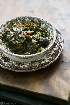 Southern Style Collard Greens ~ Slow cooked collard greens with a ham hock, onions, vinegar and hot sauce. A classic with BBQ! On SimplyRecipes.com