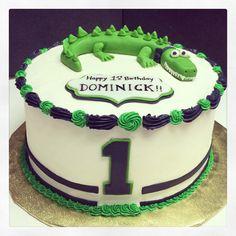 Alligator themed first birthday cake.