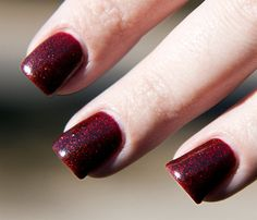 Sparkly Vampire is a mix of teeny tiny black and red glitters in a richly pigmented blackened-red jelly base.