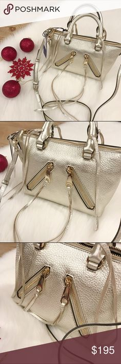 SALERebecca Minkoff Micro Moto Satchel Rebecca Minkoff mini handbag, pewter/gold color, leather, handles and adjustable strap. This is the perfect bag for the holidays! Fringes, 2 usable front zipper pockets, interior accessory pockets & dustbag. NWT.Poshmark takes 20% off my purchase.           20% off bundle 2 items or more!                             •NO TRADING                             •no lowballs                             •smoke free                             •fast shipper…