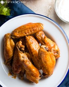 Baked buffalo wings are the best snack ever! The wings are baked until super crispy on the outside and juicy on the inside - they're just as nice as fried wings. They're then tossed in a rich hot sauce and served with a classic ranch dipping sauce. Spicy Recipes, Asian Recipes, Real Food Recipes, Cooking Recipes, Chinese Recipes, Yummy Recipes, Best Appetizers, Appetizer Recipes, Party Recipes