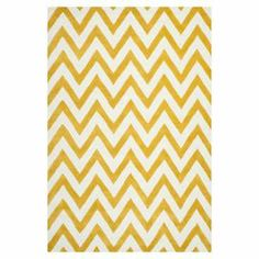 Hand-tufted wool rug in gold with a chevron motif. Made in India.   Product: RugConstruction Material: WoolColor: Gold and ivoryFeatures:  HandmadeMade in India Note: Please be aware that actual colors may vary from those shown on your screen. Accent rugs may also not show the entire pattern that the corresponding area rugs have.