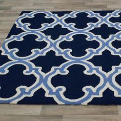 Kios Rug - not sure I love the baby blue accent.