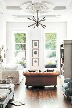 tall ceilings with ornate moldings and modern light fixture. / sfgirlbybay