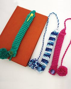 Topped with a pom-pom, crochet this buttoned pencil holder for your favorite pens or pencils.
