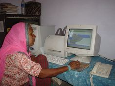 60 years rural woman is on full confident to learn new technology.