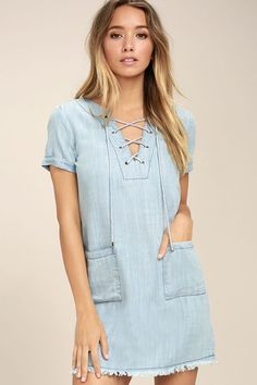 The Awayday Blue Chambray Lace-Up Shift Dress is perfect for a quick trip to the coast! Woven chambray fabric shapes this short sleeve shift dress with a lace-up neckline, front patch pockets, and a frayed, back-stitched hem.