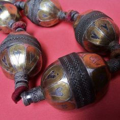 Large tekke turkoman beads. Seven large Tekke Turkoman Beads threaded as a necklace with original felt spacers (these have been bound with button hole stitch, one missing.) Partial fire gilt silver with dark oxidation on the exposed silver. Recently re threaded onto cord. Mid to Late 20th Century. Posted by Cam Knuckey.