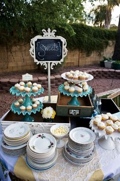 Pretty dessert buffet using vintage drawers, china and cake stands.