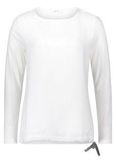 Cartoon Shirt im Basic Design für 39,99€. Muster: Unifarben, Auschnitt/Kragenform: Rundhals, Ärmel: Langarm, Passform: Lässig, Stil: regular bei OTTO