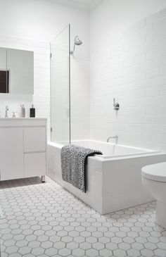 The Bathroom: A 12 Day Renovation [Complete!] white subway on wall, white hex with grey grout on floor Hexagon Tile Bathroom, Modern Bathroom Tile, Classic Bathroom, White Bathroom, Bathroom Flooring, Floor Tile Grout, Cottage Style Bathrooms, Bathroom Windows, Grey Flooring