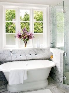 The tub is pretty, and I really like the wall mounted knobs, spigots, etc.