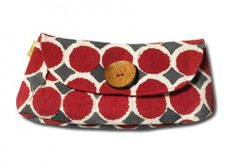 JOYN Red Dots Button Clutch   This clutch supports education and health.