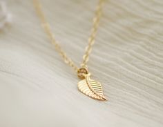Gold leaf necklace - small simple gold jewelry - edor  Very Romanesque, love it!