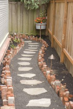 old brick from furnace chimney recycled into path boarder(AZ path in side yard) Brick Projects, Outdoor Projects, Garden Projects, Garden Ideas, Backyard Ideas, Brick Yard, Brick Patios, Broken Brick Ideas, Recycled Brick