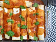 These enchiladas are filled with a creamy southwest sauce, shredded chicken, black beans, and sweet corn. A homemade enchilada sauce brings it all together.