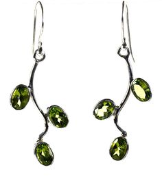 Green Grapevine Peridot Earrings - three oval facet cut green peridots are hanging off of a polished silver vine. http://simplybeautiful2012.com/green-grapevine-peridot-earrings.html#