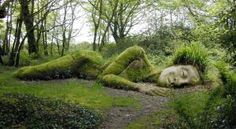 Built with mud, rocks, and plants, the extraordinary sculptures by sister and brother team Sue Hill and Pete Hill are living figures that suggest a fairy tale in the undergrowth.    Two of their best known sculptures, Mud Maid and The Giant's Head, were both commissioned by the Lost Gardens of Heligan in Cornwall, UK.