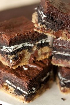 Slutty Brownies... A layer of cookie dough, oreos and brownie batter makes for the most decadent Slutty Brownies on the face of the earth!