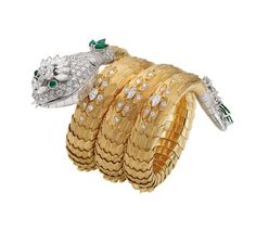 Serpenti bracelet/ watch in yellow gold and platinum, set with emeralds and diamonds, circa 1967. - photo via French Vogue