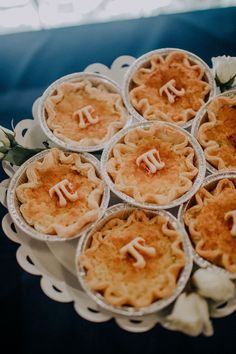 The couple leans into the Pi Day theme, opting for a sweet spread of unique mini-pies in addition to their classic three-tier wedding cake. | The Lafayette Hotel, Swim Club and Bungalows San Diego, CA
