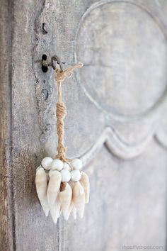 Seashell Tassle on antique key of grey armoire//