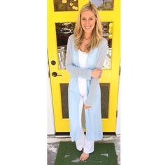 This pretty pale blue cardigan is so pretty over a column of white! #ootd details:  long blue cardigan $162 sizes XS-L. Henry & Belle flare jeans $165 sizes 26-30. #tfssi #stsimonsisland #seaisland #shopgoldenisles #spring2016