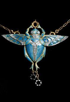 Henri Dubret - An Art Nouveau gold, cloisonné enamel and diamond scarab brooch/pendant, circa 1900. Signed H. DUBRET. Missing three stones. 4.8 x 5cm. #Dubret #ArtNouveau